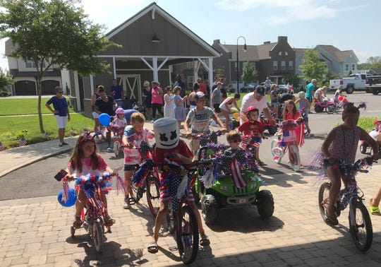 Kids on bikes, trikes and go-carts line up for Millstone's Fourth of July parade.