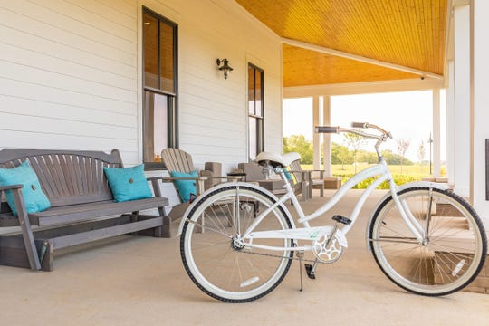 "Beach cruiser bikes are a popular way to get around in Durham Farms. ""Everybody wants one,"" said Lacey Edwards, the neighborhood's marketing manager."