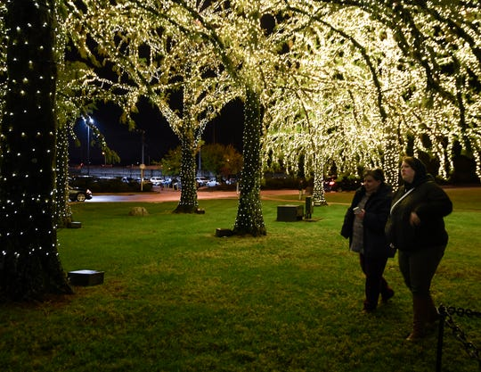Meg Glenn and Kari Bellinger enjoy the holiday lights at Gaylord Opryland Resort and Convention Center Thursday, Nov. 7, 2019 in Nashville, Tenn.