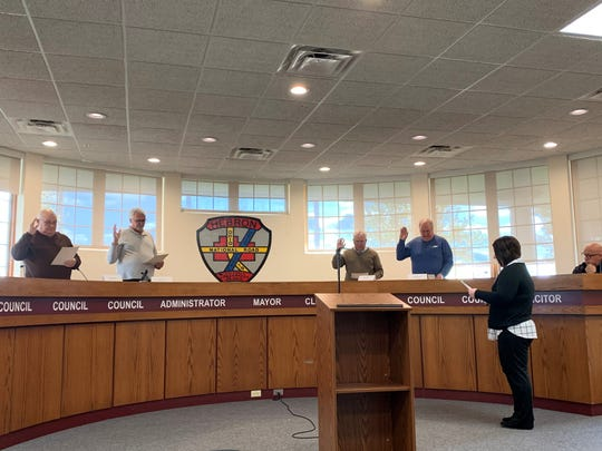 Initial trustees of the Refugee-Canyon Joint Fire District are sworn in at the beginning of the entity's first meeting at the Hebron Administration Building on Friday, Nov. 8, 2019. From left to right: Hebron councilmen Rich Moore and Jim Layton, and Union Township Trustees Randy Weekly and Charlie Prince.