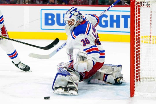 New York Rangers goaltender Henrik Lundqvist (30) makes a pad save against the Carolina Hurricanes during the second period at PNC Arena.