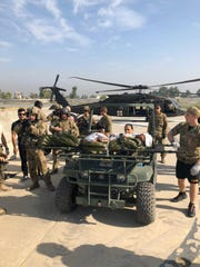 Team transporting patient from blackhawk helicopter to Forward Surgical Team at Forward Operating Base Fenty in Afghanistan.