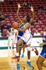 New Mexico State's Adrianna Henderson puts up a lay up against UC Riverside on Thursday at the Pan American Center.