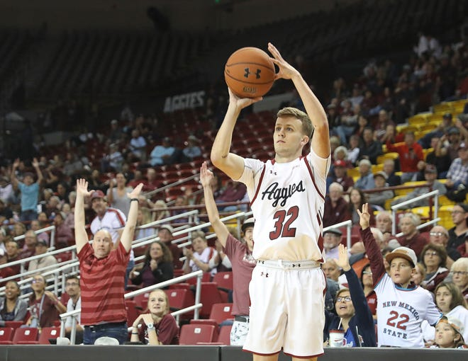 Senior Bryce Rewalt takes a shot from the corner during the Aggies' 92-46 win over Western New Mexico on Tuesday, Nov. 5, at the Pan American Center.