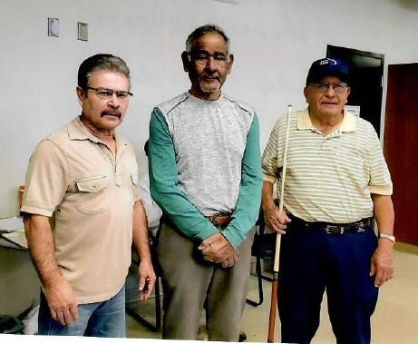 Pictured from left to right are the October 2019 eight-ball billiard's tournament winners Andy Chavira, first place, Jaime Chavando, second place and Florencio Avitia, third place.