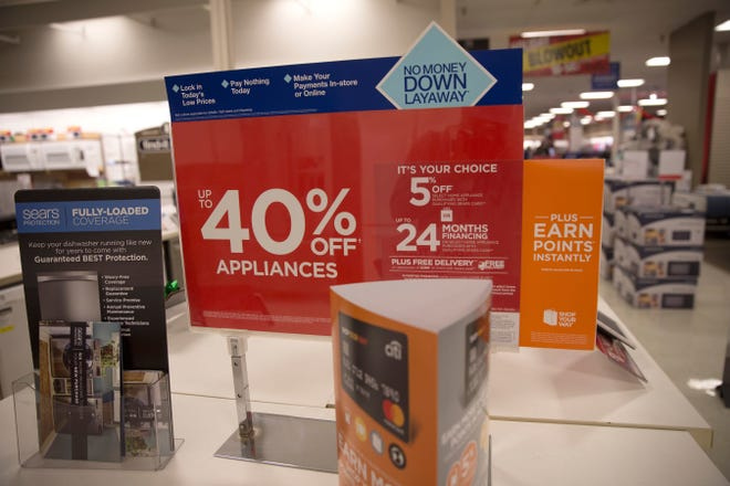 Sales cards for appliances are displayed, Friday, Nov. 24, 2017 at Sears in Farmington. The owner of Sears announced on Nov. 7, that the location would close by February.