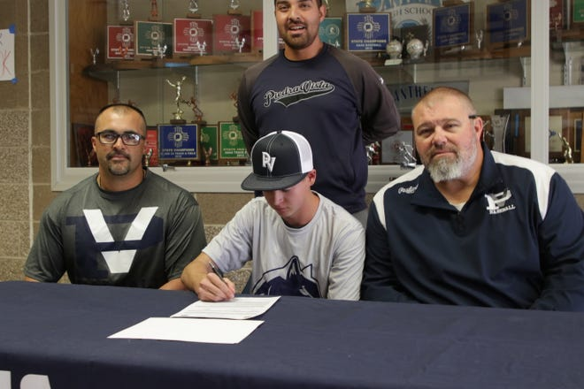 Piedra Vista's Logan Birch signs his National Letter of Intent on Friday to continue his baseball career at Paradise Valley Community College.