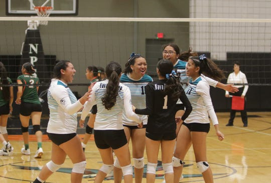 Navajo Prep celebrates clinching the District 1-3A volleyball tournament title against Wingate on Thursday at the Eagles Nest in Farmington.