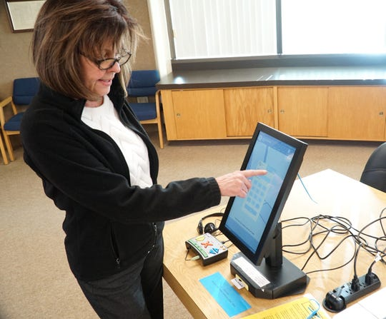 City of Livonia Elections Coordinator Janet Douglas demostrates how the city's Voter Assisted Terminals work. The voting stations, normally reserved for sight-challenged voters, came in handy in the most recent election when precints ran out of ballots due to high turnout and voters used the terminals instead.