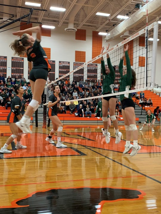 Northville's Sydney Reed goes for a kill against Novi in the district final on Nov. 7, 2019.