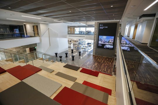 The atrium Thursday, Nov. 7, 2019, in the new Oshkosh Corporation headquarters building at 1917 Four Wheel Drive in Oshkosh, Wis., allows a view of all four stories and gives a place to sit and watch a large screen.