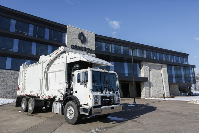 A garbage truck sits on display Thursday, Nov. 7, 2019, outside the new Oshkosh Corporation headquarters building at 1917 Four Wheel Drive in Oshkosh, Wis.