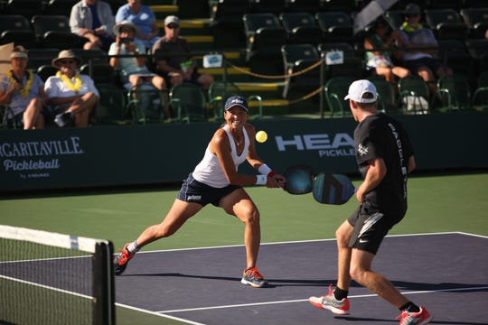 The doubles team of Simone Jardim and Kyle Yates compete Thursday at the Margaritaville USA Pickleball National Championships at the Indian Wells Tennis Garden.