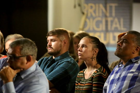 Attendees listen during the Storytellers event dedicated to homelessness at The Desert Sun in Palm Springs, Calif., on November 7, 2019.