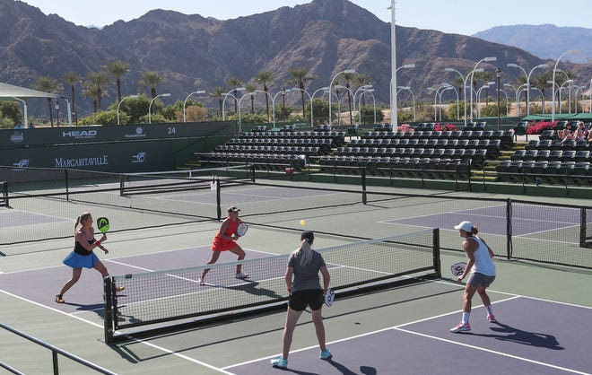 Competitors play pickleball during the Margaritaville USA Pickleball National Championships at the Indian Wells Tennis Garden, November 8, 2019.