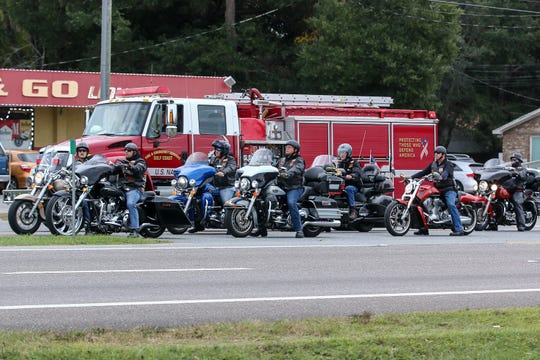 A memorial escort transporting the body of Escambia County Fire Rescue Volunteer District Chief Dwain S. Bradshaw from Sacred Heart Hospital to Pensacola Memorial Gardens makes its way along Pine Forest Road on Friday, Nov. 8, 2019. Bradshaw was killed in the early morning hours of Nov. 6 while working the scene of a fatal wreck on the Muscogee Road bridge. He was a member of the Air National Guard and also a firefighter with the Department of Defense at Naval Air Station Pensacola.