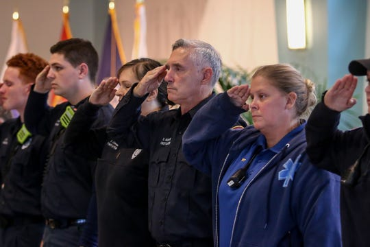 First responders from multiple area agencies line the lobby of Sacred Heart Hospital to honor Escambia County Fire Rescue Volunteer District Chief Dwain S. Bradshaw during a veteran's honor walk on Friday, Nov. 8, 2019. Bradshaw was killed in the early morning hours of Nov. 6 while working the scene of a fatal wreck on the Muscogee Road bridge. He was a member of the Air National Guard and also a firefighter with the Department of Defense at Naval Air Station Pensacola.