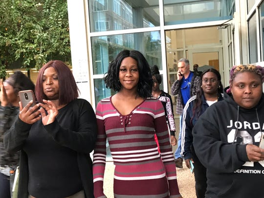 Quineka Baldwin, center, is surrounded by supporters as she walks out of the Escambia County Courthouse on Friday, Nov. 8, 2019. Baldwin's daughter and girlfriend were killed in a hit-and-run crash on Cervantes Street in June 2018. The driver, Markquise Wallace, was found guilty on all counts Friday after a week-long trial.