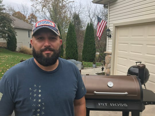 Michael Conrad stands in front of his new meat smoker at his Hanover home on Thursday. The smoker was donated to him by Mike Dunlap's Motorcycle Club.