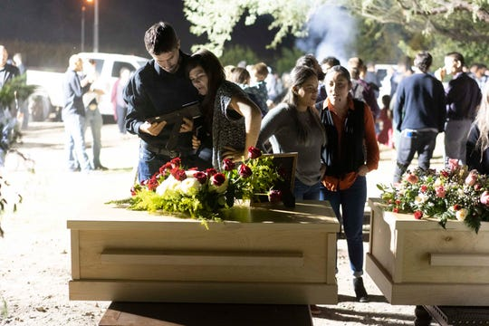 Family members gather for a wake service for Rhonita Miller, 30, and four of her children: Howard, 12, Krystal, 10, and 8-month-old twins Titus and Tiana, who were ambushed by gunmen from a drug cartel near Rancho La Mora in Sonora, Mexico. Miller will be buried with her children in Colonia LeBaron, Mexico.