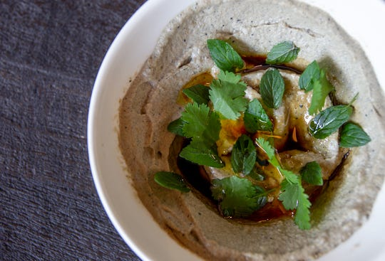 Along with more traditional Thanksgiving dishes, Rima Hafi and her family will often serve traditional Middle Eastern dishes like hummus, tabouli and the smokey eggplant dip, baba ganoush.