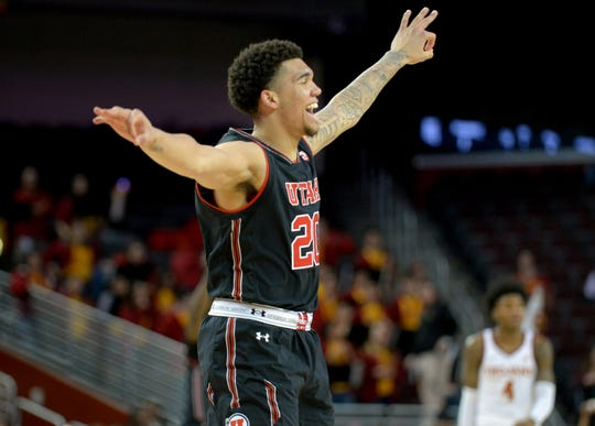 February 6, 2019; Los Angeles, CA, USA; Utah Utes forward Timmy Allen (20) reacts to a three point basket scored against the Southern California Trojans  during the second half at Galen Center.