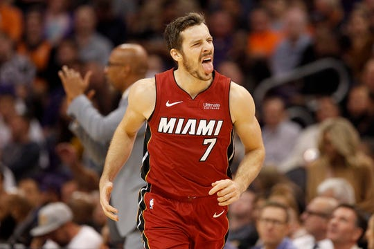Miami Heat's Goran Dragic reacts toward the Heat's bench after hitting a 3-pointer against the Phoenix Suns during the second half of an NBA basketball game Thursday, Nov. 7, 2019, in Phoenix. (AP Photo/Darryl Webb)