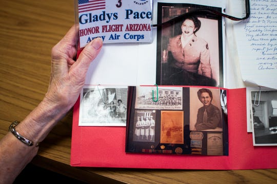 95-year-old Gladys Pace, who served in the Army Air Forces from 1944 to the end of World War II, looks through old photos from her time in the military on Nov. 7, 2019.