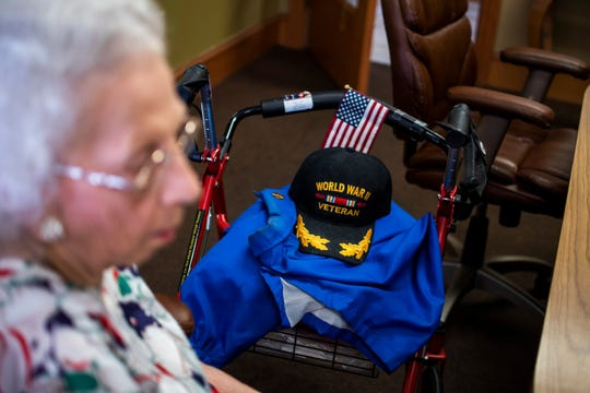 An American flag and World War II veteran hat sit on 95-year-old Gladys Pace's walker. Pace served in the Army Air Forces from 1944 to the end of World War II.