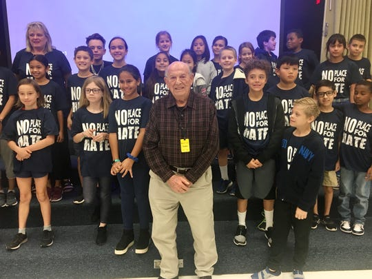 """Oskar Knoblauch with members of Kyrene del Cielo Elementary School's """"No Place for Hate"""" anti-bullying program."""