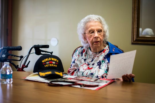 Gladys Pace, who served in the Army Air Forces from 1944 to the end of World War II, looks over notes about her time in the military at Fellowship Square senior living facility in Mesa on Nov. 7, 2019.
