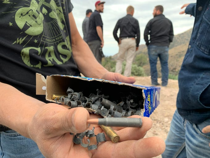 Family members scout a site in La Mora, Sonora, Mexico, on Nov. 8, 2019, where they found several bullet casings believed to be from an attack that left three women and six children dead in a Nov. 4 attack.