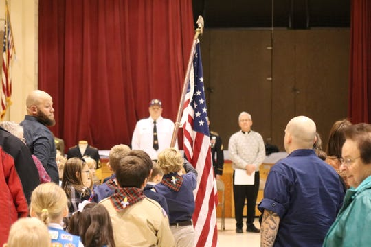Members of the Boy Scouts and Girl Scouts presented the colors as Immaculate Conception School in Port Clinton honored veterans on Friday.