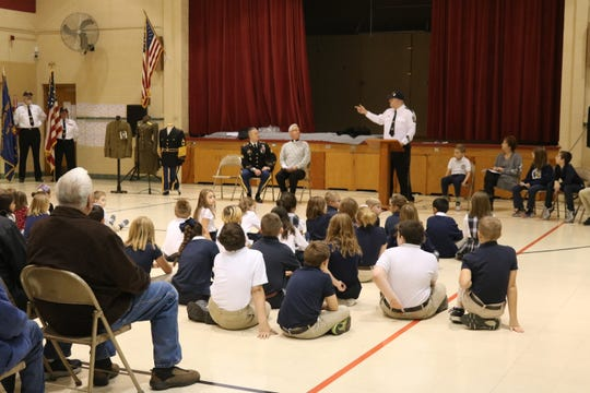 Immaculate Conception School in Port Clinton honored veterans on Friday.