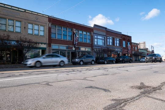 Cars drive south on Huron Avenue through downtown Port Huron. The University of Wisconsin, with Ball State University, is has ranked Port Huron seventh in an ongoing studydesigned to identify Midwest communities with the most economically vital downtowns.