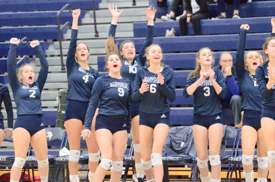 Marysville's bench celebrates scoring a point against Algonac during the Division 2 volleyball district championship on Thursday, Nov. 7, 2019.