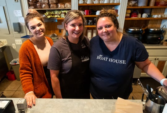 Kate Voss, right, owner of Kate's Downtown, poses for a photo with her employees Kait Sparrow, left, and Kate Miloch, Friday, Nov. 8, 2019, in her downtown restaurant.