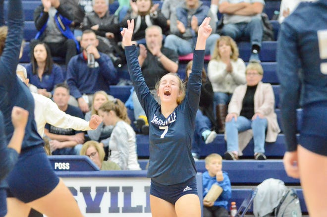 Marysville's Lydia Goold celebrates getting a kill against Algonac during the Division 2 volleyball district championship on Thursday, Nov. 7, 2019.