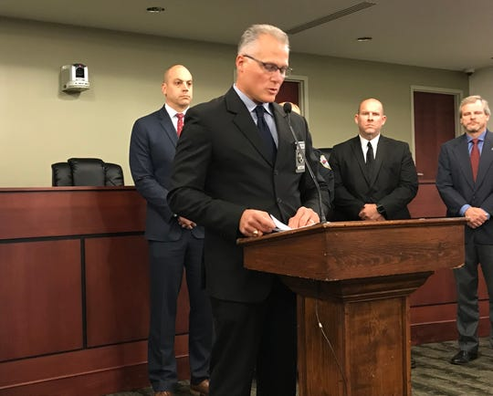 U.S. Marshal Martin Pane, center, speaks during a news conference at York City Hall on Friday to announce the arrest of 71 people in Operation Slow Burn. The four-day fugitive sweep was conducted from Nov. 1 through 4. It was aimed at reducing violent crime.
