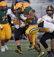 Bishop Manogue's Zeke Lee is tackled from behind by Galena's Ethan Anderson as he runs on Oct. 28, 2019.