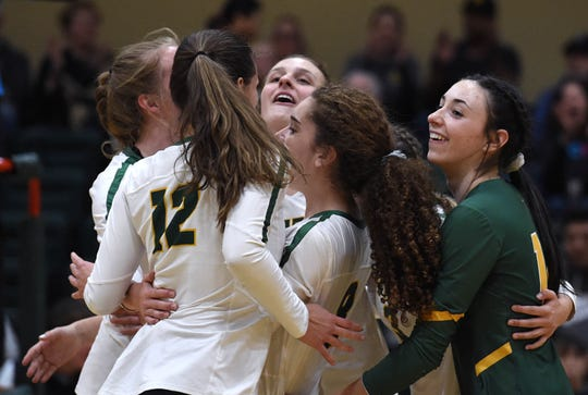 Bishop Manogue celebrate a semifinal win against Spanish Springs at Bishop Manogue High School. Manogue beat Spanish Springs 3-0.