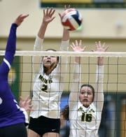 Manogue's Tatum Moreno, left, and Seriah McKinney go up for the block against Spanish Springs during Thursday's regional semifinal match at Bishop Manogue High School. Manogue beat Spanish Springs 3-0.