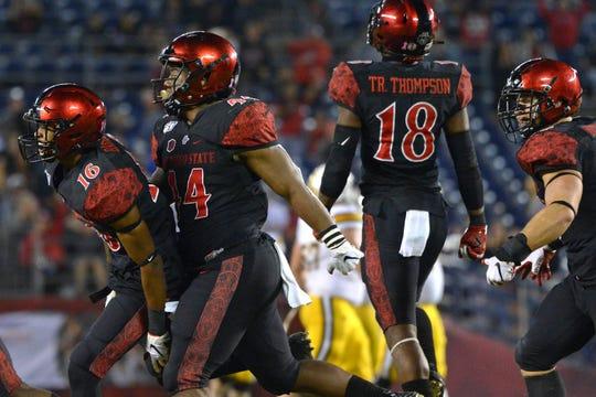 The San Diego State defense celebrates an interception against Wyoming earlier this season.