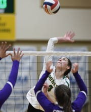 Manogue's Tori Harper goes up to spike the ball against Spanish Springs during Thursday's regional semifinal match at Bishop Manogue High School. Manogue beat Spanish Springs 3-0.
