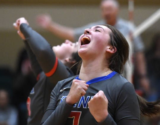 Reno's Katelyn Garnett celebrates against Damonte during Thursday's regional semifinal match at Bishop Manogue High School.