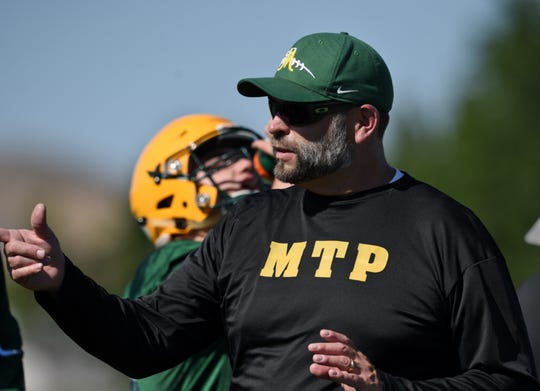 Bishop Manogue football coach Ernie Howren gives instructions during practice on Aug. 12, 2019.