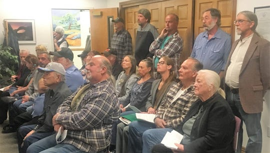 A standing-room-only crowd spoke against Desert Wells Preserve during Thursday's board of commissioners meeting.