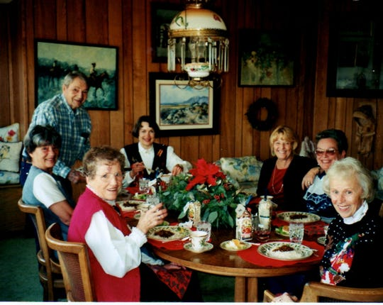 Enjoying Christmas fun at a holiday party hosted by Kay Winters a long time ago: (from left) May Walmsley, Del Minor, JohnD, Sheila Winters, Laura Tennant, Rita Quilici Selmi and Kay Winters.