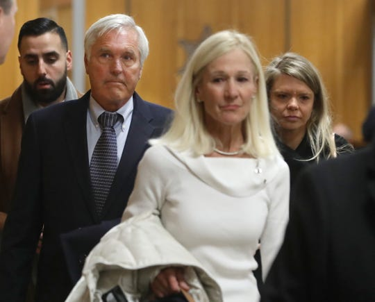 James Krauseneck, second from left, walks into court, with daughter Sara, right, and wife Sharon, to face charges in the 1982 murder of his then-wife Cathleen, Friday, Nov. 8, 2019 at the Hall of Justice in Rochester.