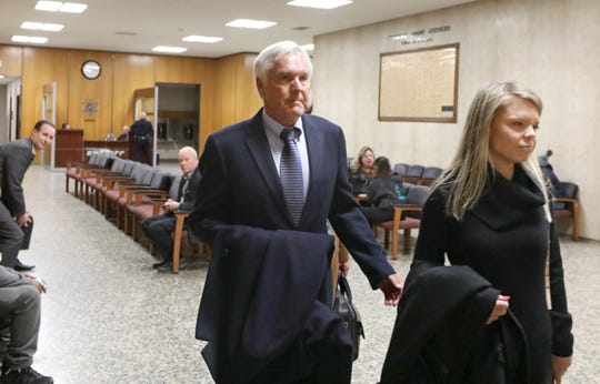 James Krauseneck walks into court, with daughter Sara, to face charges in the 1982 murder of his then-wife Cathleen, Friday, Nov. 8, 2019 at the Hall of Justice in Rochester.